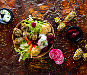 Falafel bowl with hummus and lettuce