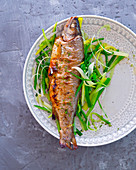 Fried trout on a bed of leek