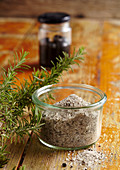 Homemade Mediterranean black olive salt with fresh rosemary