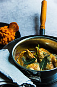 Poussin with sage in a pot served with mashed sweet potatoes