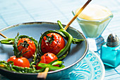 Fingerfood skewers with tomatoes and wild asparagus served with Sauce Hollandaise