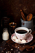 Black coffee with white chocolate and coconut cookies