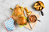 Burgers with potato wedges and sugo