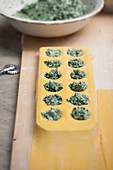 Spinach and ricotta ravioli being made