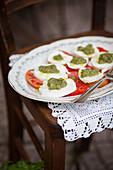 Tomatoes with mozzarella and courgette pesto (Italy)