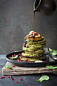 Spinach pancakes with pomegranate seeds
