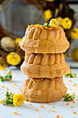 A stack of three mini Bundt cakes with honey