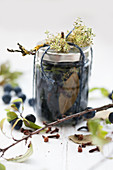 A jar of preserved sloes