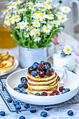 Pancakes with summer berries - blueberries and blackberries for breakfast