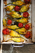 Stuffed courgette flowers with cherry tomatoes (Italy)