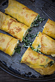 Stuffed, gratinated pancakes with kale