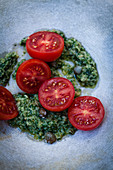 Fresh tomatoes with salsa verde and capers