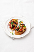 Crostini con la caponata (sweet and sour vegetables on toasted bread, Italy)