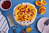 Pavlova with orange curd and pomegranate