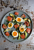 Lemon pickled salmon with eggs, avocado and browned butter