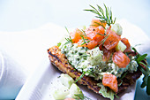 Smoked salmon with cucumber and a herb dip on a wholemeal rösti with dill and rocket