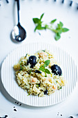 Vegan couscous salad with chickpeas, herbs and olives