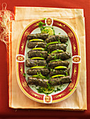 Stuffed vine leaves with sliced lime