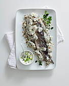 Bass in a salt-and-pepper crust with a yoghurt sauce