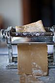 Chestnut pasta dough in a pasta machine