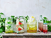 Elderflower, mint and cucmber flavoured water, Watermelon and lime quencher, Rhubarb and rose drink, Spicy apple spritzer
