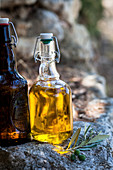 Olive oil in a bottle on a stone wall