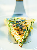 Frittata with wild herbs on a cake slice