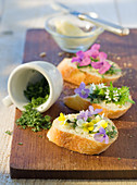 Wild herb crostini with edible flowers