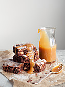 Chocolate and Macadamia Nut Brownies with Salted Caramel Sauce