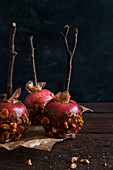 Making toffee apples with ripe red apples