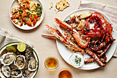 Tablescape featuring platters of fresh seafood and flatbread