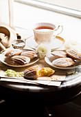 Gluten-free lemon madeleines served with tea
