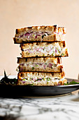 Indian yoghurt sandwiches, piled on a plate