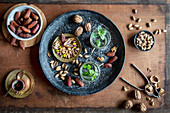 Healthy teatime oriental style with mint tea, dates, walnuts and pistachios
