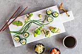 Springlike vegan maki and nigiri sushi with smoked tofu, mushrooms, fresh fruit and vegetables