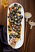 Plate of roasted vegetables - brussels sprouts, carrots and garlic