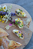 White bread and floral butter decorated with wild summer flowers
