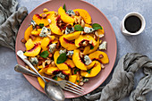 Peach salad with a fork and spoon to serve