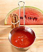 Watermelon and cinnamon jelly in a saucepan