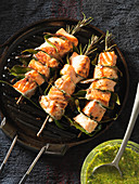 Salmon skewers with rosemary and bay leaves