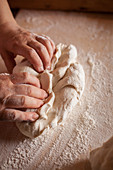 A man kneading bread dough