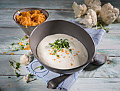 Cauliflower soup with cress and yellow lentils