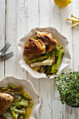 Roasted skin-on chicken thighs with leek and wine sauce
