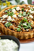 Roasted vegetable and feta quiche with caramelised red onion