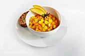 Mango, carrot and pumpkin stew with toast and star anise