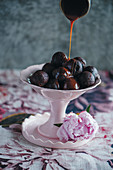 Chocolate pastry balls with whiskey caramel sauce