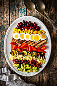 Cobb salad with vegetables, cheese, beef, corn and egg (USA)