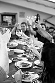 Wine lovers with raised glasses in a restaurant