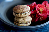 Macarons and flowers in a bowl