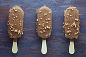 Ice lollies with a chocolate and nut glaze